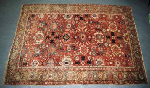Persia, full-nineteenth century, around the middle of the century.Admirable ancient tribal Heriz carpet Serapi to birds, flowers and stars stylized.