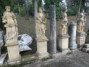 Four stone statues representing the four seasons